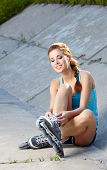 Beautiful young woman rink on roller-skate