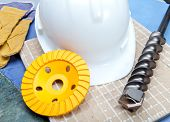 The drill grinding disk for operation on concrete a helmet protective and gloves working