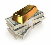 Goldbar on a stack of dollars.