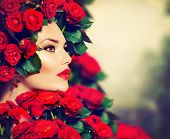 Beauty Fashion Model Girl Portrait with Red Roses Hairstyle. Red Lips and Nails. Beautiful Luxury Ma