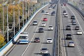 stock photo of gory  - Many modern cars go on bridge at sunny day in Moscow - JPG