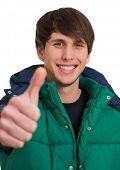 Man Wearing Wind-cheater And Showing Thumb Up Sign Over White Background