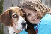 stock photo of droopy  - a cute picture of a young beagle and a little girl - JPG