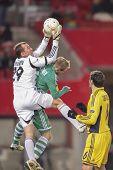 VIENNA, AUSTRIA - DECEMBER 6 Mario Sonnleitner (#6 Rapid) and Oleandr Groyainov (#29 Metalist) fight
