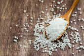 stock photo of crystal salt  - Sea salt over wooden background selective focus close up - JPG