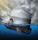stock photo of save water  - A house is sinking in water for a mortgage debt or natural disaster concept - JPG