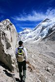 Man hiking towards the Mount Everest Base Camp with Mount Everest (8848m) in the background