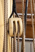 foto of pulley  - photograph of a nautical wood pulley two strings - JPG