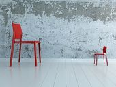pic of opposites  - Huge and small chair standing against each other - JPG