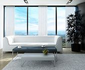 White couch with nice side tables against huge window with panoramic view