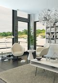 White relax chairs against windows with beach view
