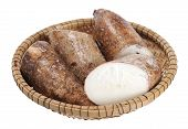 picture of cassava  - chopped cassava in bamboo bucket isolated on white background - JPG
