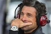 Daytona Beach, FL - Jan 04, 2014:  Driver, Patrick Dempsey, watches his crew work during the Roar Be