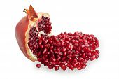 Half Of Pomegranate And Pomegranate Seeds