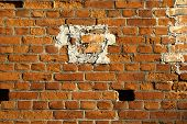 stock photo of divergent  - Naturally aged brick wall repaired with divergent pieces - JPG