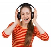 Happy Girl Listens To Music On Headphones