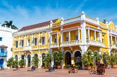 Yellow And White Colonial Building