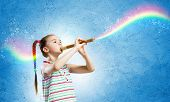 Image of little cute girl playing on flute