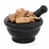 Reed root chinese herbal,medicine in a mortar with pestle over white background. Lu gen. Rhizoma phr