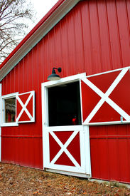 pic of red siding  - Large red barn with an open half door - JPG