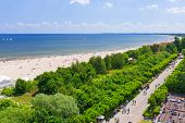 SOPOT, POLAND - 7 JUNE: People on the beach of Sopot at Baltic Sea on 7 June 2014. Sopot is major health and tourist resort destination and has the longest wooden pier in Europe.