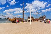 SOPOT, POLAND - 7 JUNE: Pirate galleon at Sopot molo on Baltic Sea, 7 June 2014. Sopot is major tourist resort destination and this pier with 511.5 meters long is the longest wooden pier in Europe.
