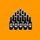 stock photo of pyramid shape  - beer bottles grouped to shape of pyramid - JPG
