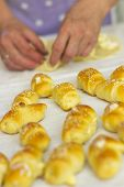 Baker making mini croissants, close up