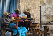 HAVANA, CUBA - JANUARY 30, 2011: Street musicians in Plaza de la Catedral San Cristobal, in Old Hava