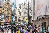 HONG KONG - MAY 17, 2014: Pedestrians walk in the district of Causeway Bay in Hong Kong. Causeway Bay is the world�?�¢??s costliest retail location.