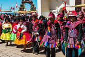 PUNO, PERU - JULY 25, 2013: musicians and dancers in the peruvian Andes at Taquile Island