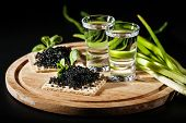 Vodka And Black Caviar On Black Background