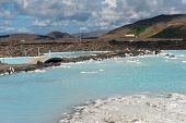 Blue water of the famous Icelandic Blue Lagoon spa is produced by near geothermal plant. The spa is located on Reykjanes peninsula not far from Keflavik airport and Reykjavik capital, Iceland.