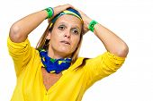 Tense Brazilian woman supporter for a misseg goal chance on white background