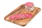 Slices Of Salami On Wooden Board