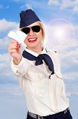 Stewardess Holding Paper Airplane