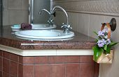 Double sinks in a marble countertop in the bathroom