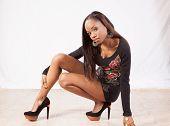 Black woman squatting