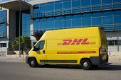 VALENCIA, SPAIN - JUNE 13, 2014: A DHL delivery van on the street in Valencia. DHL is a world wide c