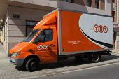 VALENCIA, SPAIN - JUNE 10, 2014:  A TNT Express truck in Valencia.  TNT Express is an international courier delivery services company with sales of over 6.69 billion euros in 2013.