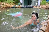 MUSKOGEE, OK - MAY 24: A mermaid greets children at the Oklahoma 19th annual Renaissance Festival on