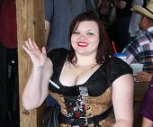 MUSKOGEE, OK - MAY 24: A busty woman dressed in corset and costume stops for the picture at the Okla