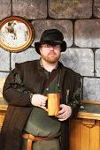 MUSKOGEE, OK - MAY 24: A man dressed in historic clothing enjoys a drink during the Oklahoma 19th annual Renaissance Festival on May 24, 2014 at the Castle of Muskogee in Muskogee, OK.