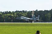 BERLIN, GERMANY - MAY 20, 2014: Jet fighter Mikojan-Gurewitsch MiG-29 (Polish Air Force) demonstrati