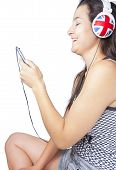Young Girl Smiling With Phone And Headphones