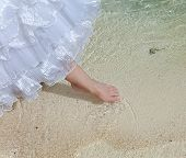 The foot of the bride touches water in the sea