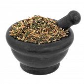 Lotus flower plumule chinese herbal medicine in a black stone mortar with pestle over white backgrou