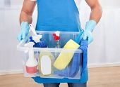 Janitor With A Tub Of Cleaning Supplies