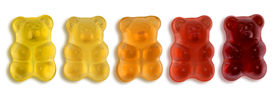 image of gummy bear  - some colorful gummy bears in light back - JPG
