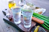 image of vodka  - vodka and cucumbers on the wooden table - JPG